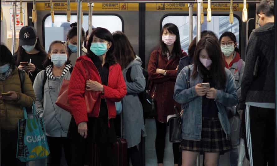 Train passengers in Taipei, Taiwan.