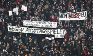 Frankfurt supporters display banners protesting an increase in Monday night Bundesliga matches.