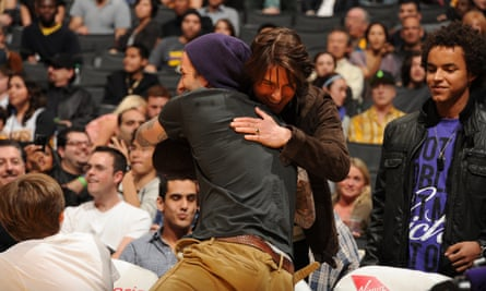 David Beckham and Tom Cruise greet each other at an NBA game in 2011