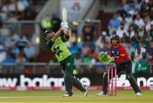 Pakistan's Mohammad Rizwan hits a six.