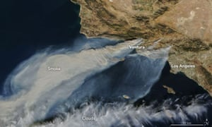 Nasa satellite footage captured on 5 December shows thick smoke streaming from several fires in southern California.