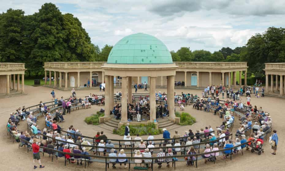 Cawston Brass Band play Eaton Park's grand pavilion in Norwich.