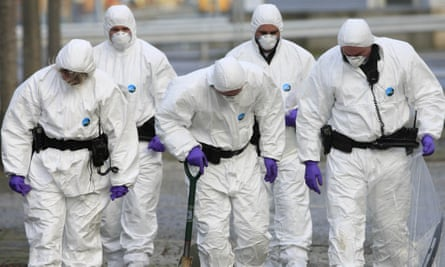 A Police forensic team search in front of the Policing Board headquarters in Belfast, Northern Ireland, on November 23, 2009.