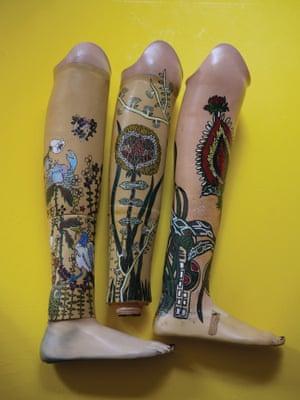 Some of Katayama's decorated prosthetic legs.