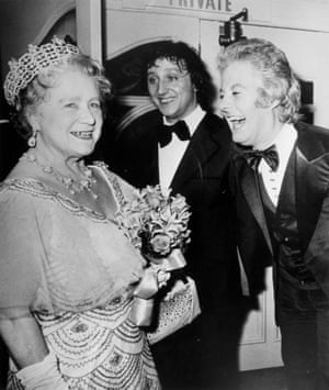 Elizabeth, the Queen Mother swaps jokes with Dodd and impersonator Danny La Rue after attending a Royal Variety Performance at the London Palladium in 1972.