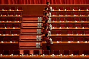 Attendants prepare tea inside the Great Hall of the People before the opening