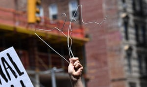 A woman holds coat hangers as she takes part in a abortion rights rally in front of the Middle Collegiate Church in the East Village of New York on May 21, 2019