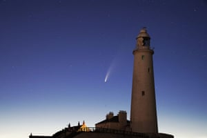 Neowise passes St Mary's lighthouse in Whitley Bay, in north-east England, in the early hours of 14 July