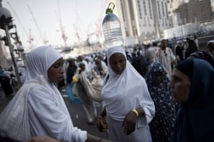 A pilgrim carries a bottle of Zamzam water from a sacred well in Mecca