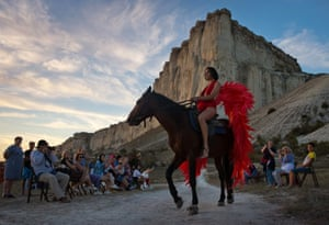 Ak-Kaya Rock , CrimeaA model wearing a creation rides a horse during an outdoor fashion show for collections by Crimean designers near Belgorsk during the 2020 Crimean Fashion Week
