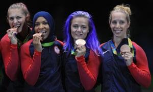 Bronze medalists Monica Aksamit, Ibtihaj Muhammad, Dagmara Wozniak and Mariel Zagunis celebrate their bronze medal.