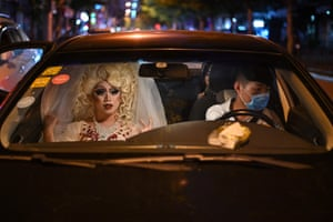 Drag queen Yan Anyu, or Miss Cream, rides in a taxi in Shanghai, 13 June