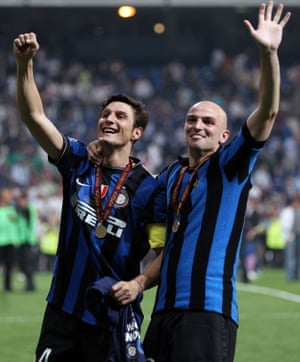 Javier Zanetti and Esteban Cambiasso, wearing Giacinto Facchetti's old shirt, celebrate at the end of the Champions League final.
