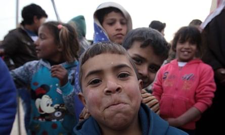 Syrian children pose for the camera at the Zaatari refugee camp in Mafraq, Jordan.