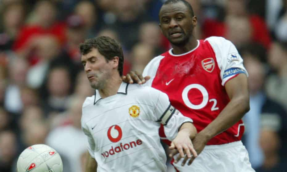 Patrick Vieira gets stuck in with Manchester United's Roy Keane
