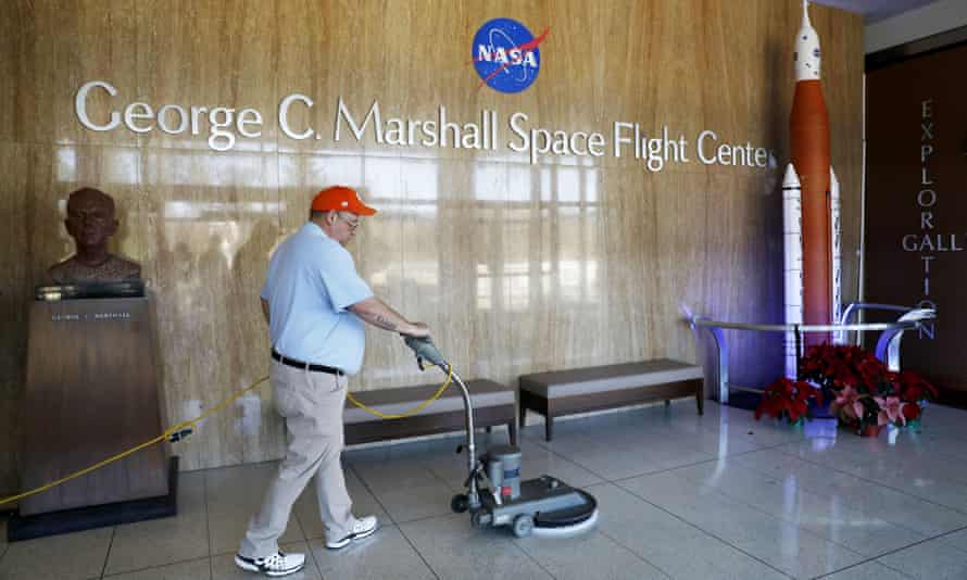 A worker cleans the floors at NASA's Marshall Space Flight Center in Huntsville, Alabama, which has been impacted by the partial federal government shutdown.