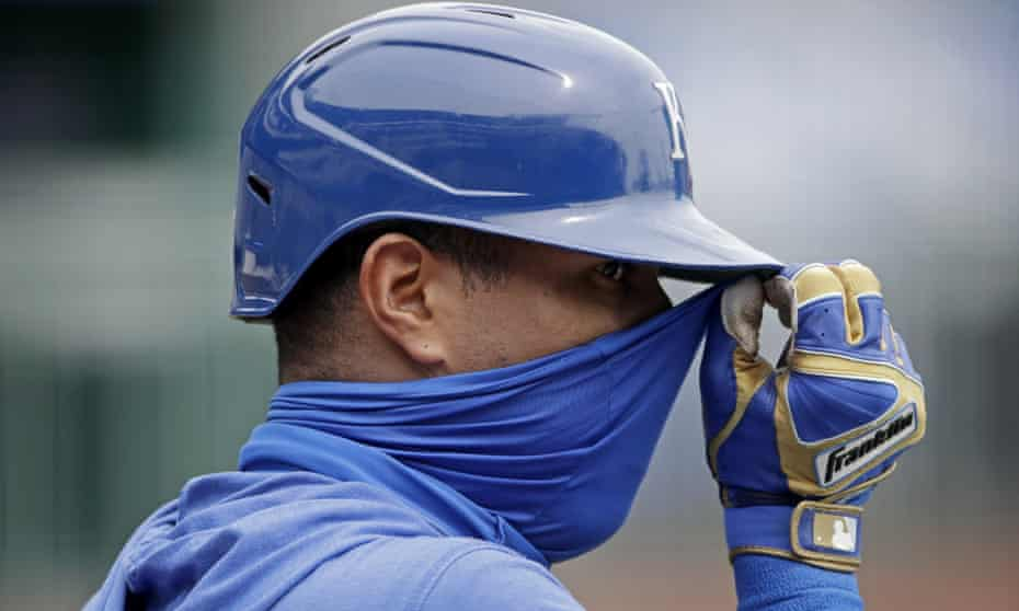The Kansas City Royals' Salvador Perez adjusts his mask during batting practice. He tested positive for Covid-19 earlier this summer