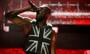 Stormzy wore a stab-proof union jack vest created by Banksy at his Glastonbury gig on Friday.