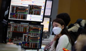 South Korean dealers work in front of monitors at the Hana Bank in Seoul, South Korea, today