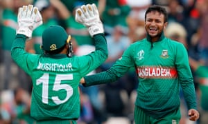 Bangladesh's Shakib Al Hasan celebrates with teammate Mushfiqur Rahim after the dismissal of Afghanistan's Najibullah Zadran