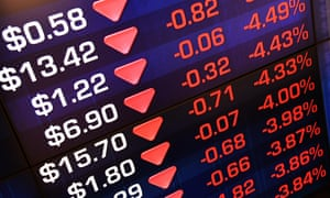 Market trading boards show losses at the Australian Securities Exchange in Sydney on Friday.