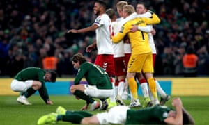 Denmark celebrate reaching Euro 2020 as the Republic of Ireland players hit the floor in disappointment.