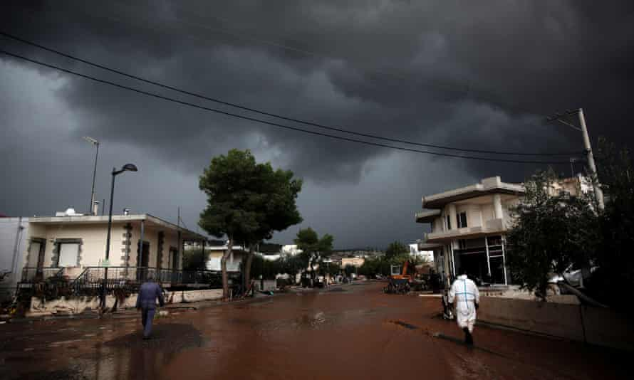 Storm clouds over a flooded street in Mandra