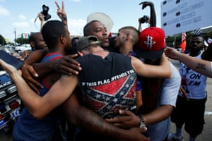 A group of men hug after taking part in a prayer circle following a Black Lives Matter protest in Dallas, Texas