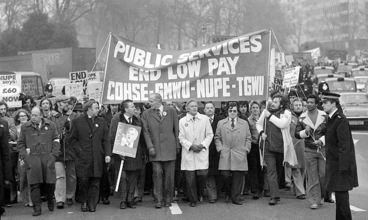 Alan Fisher (white mac) of Nupe, and David Basnett (centre) of the GMWU head a mass march to Parliament during the 1978-79 'winter of discontent'.