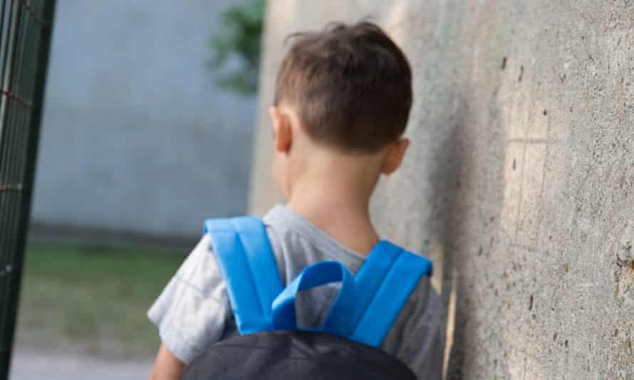 A boy in a schoolyard