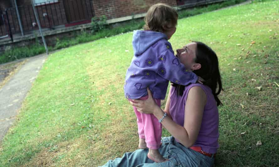 A young single mother with her daughter in a council estate, Bristol, UK.. Image shot 2003. Exact date unknown.