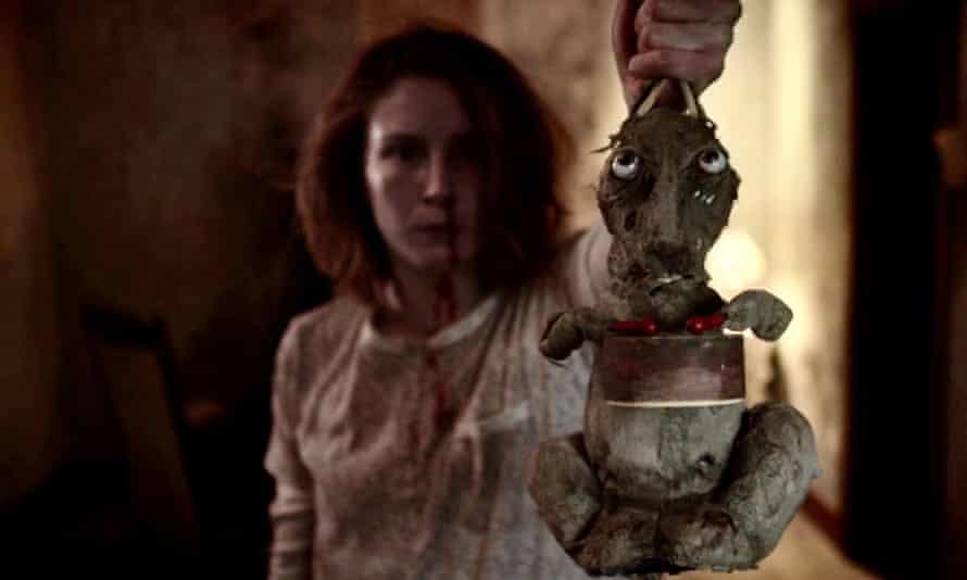 Leila Sykes as Olga, with rabbit, in Caveat.