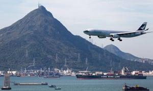 A Cathay Pacific jet prepares to land at Hong Kong International airport