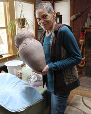 Wampanoag artist Ramona Peters with her ceramic cooking pot, on display at Mayflower 400: Legend & Legacy exhibition.