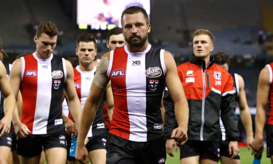 Jarryn Geary of the Saints leads the team off the field after a their loss to the Adelaide Crows at Etihad Stadium on Saturday.