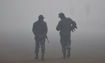 Indian security forces in heavy smog in Delhi.