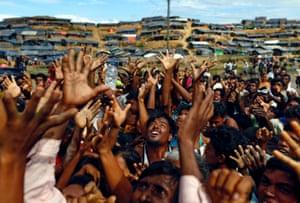 Rohingya refugees wait for aid at Balukhali makeshift refugee camp in Cox's Bazar, Bangladesh