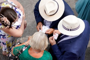 Racegoers sort out their betting tickets