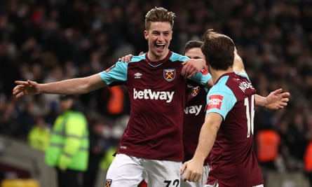 Reece Burke celebrates his extra-time winner with West Ham captain Mark Noble.