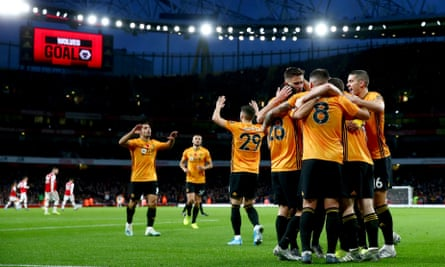 Wolves celebrate their equaliser at the Emirates.