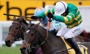 Barry Geraghty and Defi Du Seuil clear the last ahead of Un De Sceaux en route to winning the Tingle Creek at Sandown