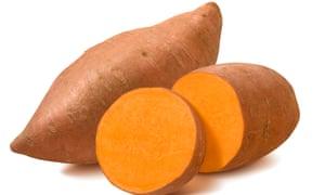 Whole sweet potato and slices isolated on white background