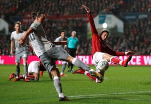 Ibrahimovic shoots under pressure from Brownhill.