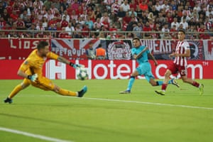 Olympiakos goalkeeper Jose Sa saves a shot from Dele Alli of Tottenham Hotspur.