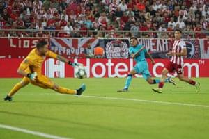 Olympiakos goalkeeper Jose Sa saves a shot from Dele Alli of Tottenham Hotspur.