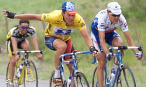 Lance Armstrong  gestures as he rides alongside Alex Zulle on the way to Pau in 1999
