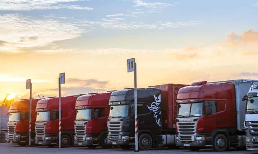row of massive red trucks