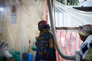 A relative talks to a patient who has tested positive for Ebola from behind a bio cube plastic barrier at the Ebola Treatment Centre in Beni, run by the Alliance for International Medical Action (Alima)