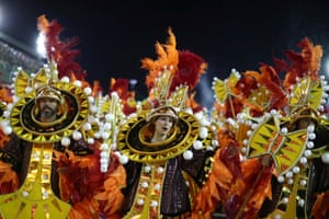 Performers from the Grande Rio samba school join the parade