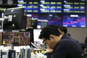 A currency trader at the foreign exchange dealing room of the KEB Hana Bank headquarters in Seoul, South Korea, today.